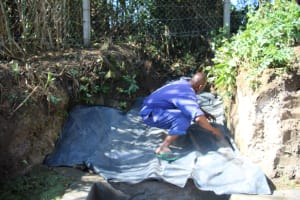 The Water Project: Mayuge Community, Ucheka Spring -  Backfilling With Polythene