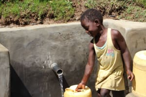 The Water Project: Mayuge Community, Ucheka Spring -  Collecting Water