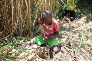 The Water Project: Mayuge Community, Ucheka Spring -  Digging Holes For Fence Poles