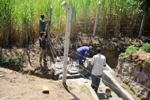 The Water Project: Mayuge Community, Ucheka Spring -  Fencing