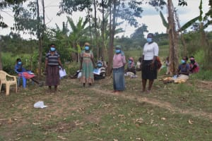 The Water Project: Mayuge Community, Ucheka Spring -  Elected Water User Committee Leaders And Field Officer Betty