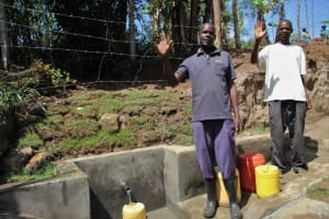 The Water Project: Mayuge Community, Ucheka Spring -  Men Give A Wave Of Thanks