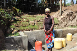 The Water Project: Mayuge Community, Ucheka Spring -  Posing Formally While Fetching Water