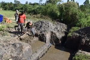 The Water Project: Makale Community, Kwalukhayiro Spring -  Laying Foundation Of Spring