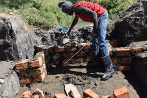 The Water Project: Makale Community, Kwalukhayiro Spring -  Pipe Setting