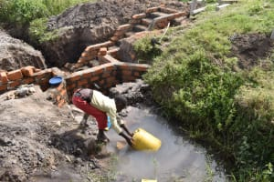 The Water Project: Makale Community, Kwalukhayiro Spring -  Boy Fetches Water For Home Use As Construction Continues