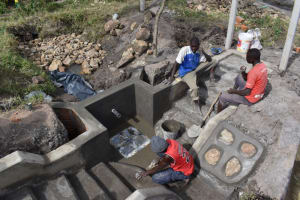 The Water Project: Makale Community, Kwalukhayiro Spring -  Backfilling With Stones