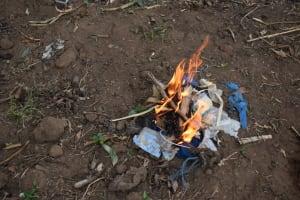 The Water Project: Makale Community, Kwalukhayiro Spring -  Hygiene Training On Burning Nondecomposable Material