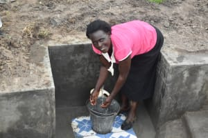 The Water Project: Makale Community, Kwalukhayiro Spring -  Mary Nashimi Collecting Water