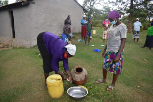 The Water Project: Makale Community, Kwalukhayiro Spring -  Participant Washes A Water Storage Pot During Water Handling And Storage Topic