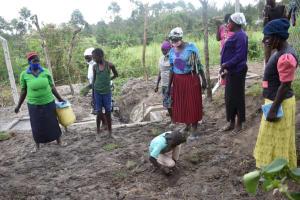 The Water Project: Makale Community, Kwalukhayiro Spring -  Site Maintenance Training And Grass Planting