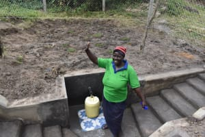 The Water Project: Makale Community, Kwalukhayiro Spring -  Thumbs Up While Collecting Water