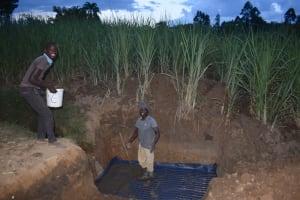 The Water Project: Wepika Community, Musa Mmasi Shikwe Spring -  Slab Setting