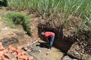 The Water Project: Wepika Community, Musa Mmasi Shikwe Spring -  Brick Setting And Wall Measurements