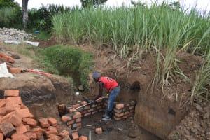 The Water Project: Wepika Community, Musa Mmasi Shikwe Spring -  Pipe Setting