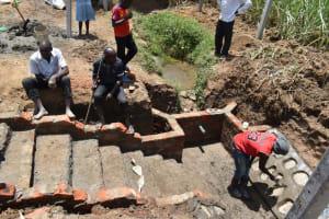 The Water Project: Wepika Community, Musa Mmasi Shikwe Spring -  Stone Pitching