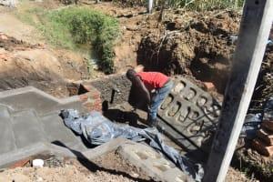 The Water Project: Wepika Community, Musa Mmasi Shikwe Spring -  Plastering