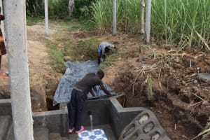 The Water Project: Wepika Community, Musa Mmasi Shikwe Spring -  Backfilling With Polythene