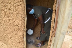 The Water Project: Wepika Community, Musa Mmasi Shikwe Spring -  Disinfecting Her Latrine As Part Of Training Practical