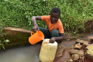 The Water Project: Sundulo B Community, Luvisia Spring -  Collecting Water