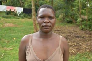 The Water Project: Sundulo B Community, Luvisia Spring -  Jean Satia