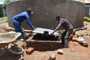 The Water Project: Gimarakwa Primary School -  Cover Placement