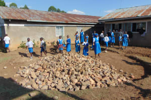The Water Project: Gimarakwa Primary School -  Students Help Place Stones For The Foundation