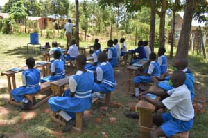 The Water Project: Gimarakwa Primary School -  Demonstrating How To Make A Leaky Tin