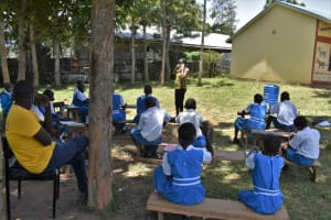 The Water Project: Gimarakwa Primary School -  Demonstration On How To Wear A Mask Correctly
