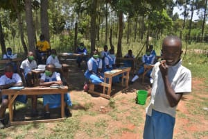 The Water Project: Gimarakwa Primary School -  Dental Hygiene Demonstration Using A Chewing Stick