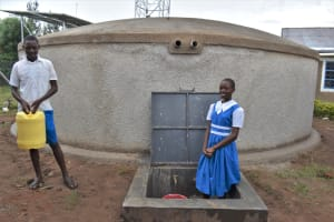 The Water Project: Gimarakwa Primary School -  Students Fetch Water From The Rain Tank