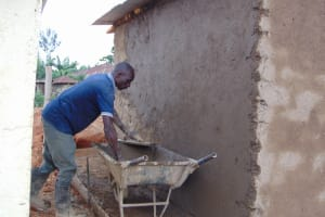 The Water Project: Saosi Primary School -  Plastering The Outside Of The Toilets