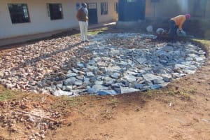 The Water Project: Saosi Primary School -  Filling Foundation With Stone