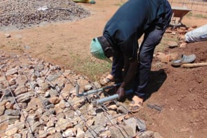 The Water Project: Saosi Primary School -  Setting Pipes In Place