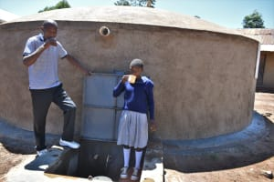The Water Project: Saosi Primary School -  Drinking Water From The Rain Tank