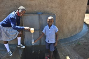 The Water Project: Saosi Primary School -  Pupils Celebrating At The Tank