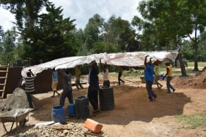 The Water Project: Shikomoli Primary School -  Placing The Frame Of The Dome