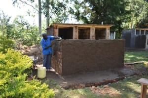 The Water Project: Shikomoli Primary School -  Toilet Plaster Works