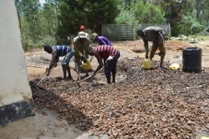 The Water Project: Shikomoli Primary School -  Concrete Mixing