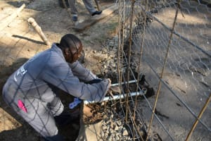 The Water Project: Shikomoli Primary School -  Tap And Outlet Setting