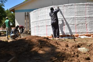 The Water Project: Shikomoli Primary School -  Sugar Sack Placing