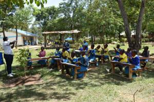 The Water Project: Shikomoli Primary School -  Facilitator Showing Ten Steps Handwashing