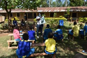 The Water Project: Shikomoli Primary School -  Mask Making Demonstration