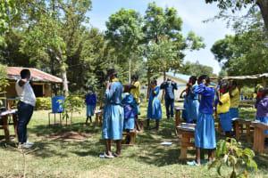 The Water Project: Shikomoli Primary School -  Proper Mask Wearing Demonstration