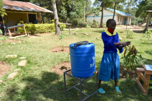 The Water Project: Shikomoli Primary School -  Student Practices Handwashing Steps
