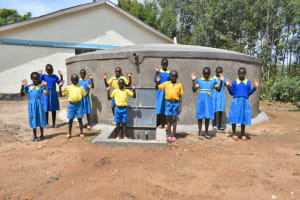 The Water Project: Shikomoli Primary School -  Students Posing At Water Tank