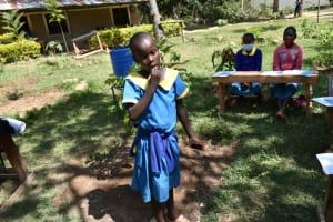 The Water Project: Shikomoli Primary School -  Toothbrushing Demonstration
