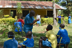 The Water Project: Shikomoli Primary School -  Trainer Amos Emisiko In Action