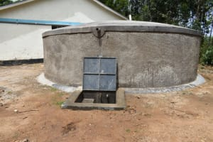 The Water Project: Shikomoli Primary School -  Rain Tank With Flowing Water
