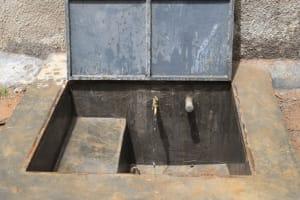 The Water Project: Shikomoli Primary School -  Water Flows From Rain Tank